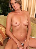 Small Tits Pretty Milf Sitting On The Couch - naked older lady with perky titty